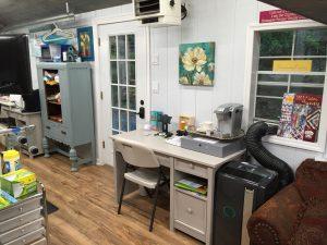 The  work desk and front door area.